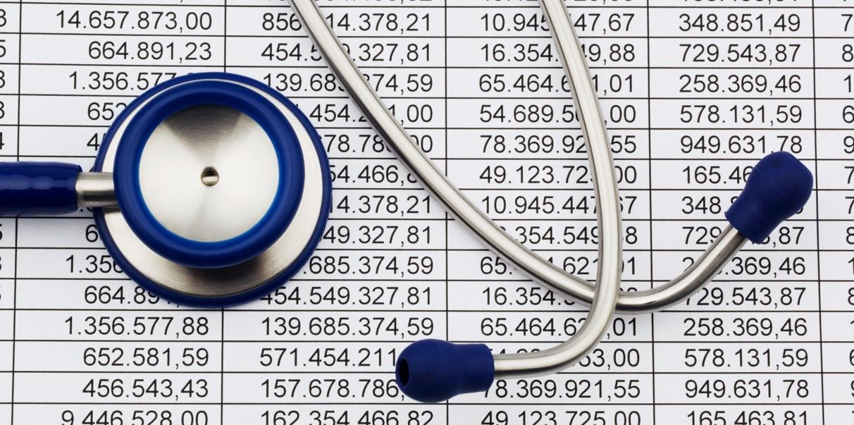 Balance sheet figures and stethoscope
